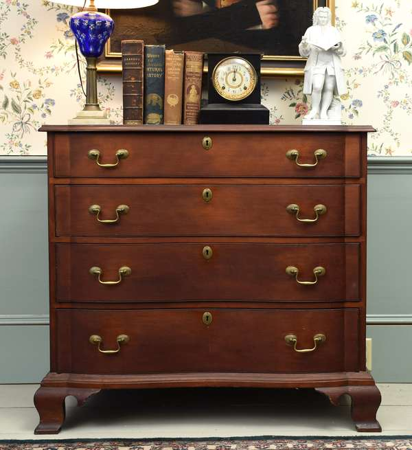 Good Chippendale cherry oxbow front chest with blocked ends on ogee feet, 36