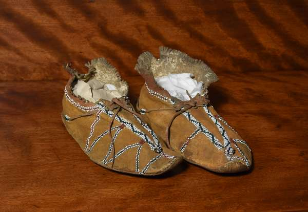 Pair of 19th C. Apache moccasins painted with unusual bead-work, 10