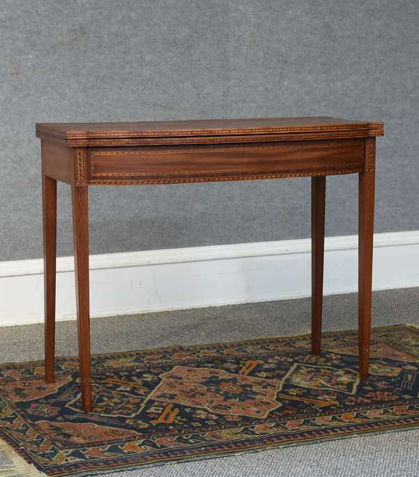 Fine N.H. birch card table with intricate inlays that match inlays on a documented Dunlap card table, ca.1810-, 35