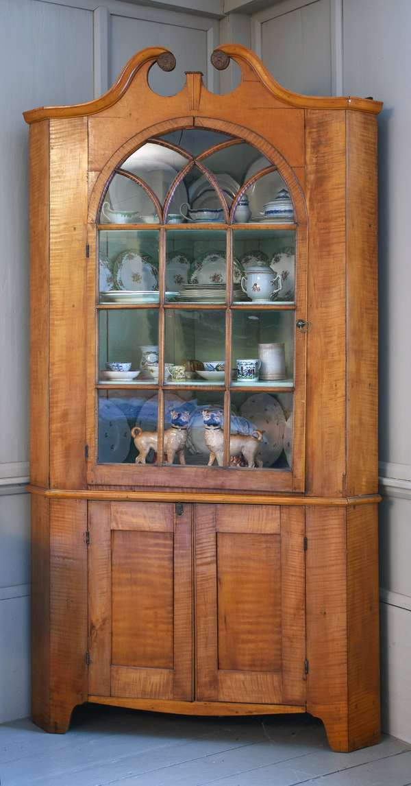 Federal two-part tiger maple corner cupboard with swan's neck pediment crest, single door with early glass panes, 88