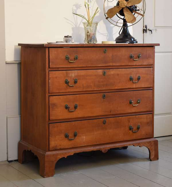 Chippendale curly maple New England four drawer chest, applied bracket base with fan carved drop pediment, old brass, 37