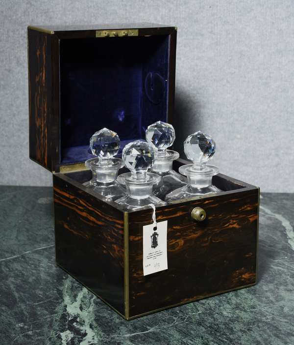 Good brass bound coromandel decanter box labeled by Thornhill Makers, Bond St London with four quality crystal decanters, 10