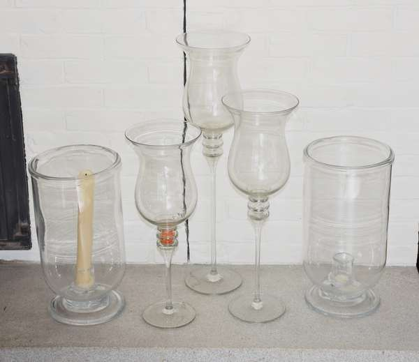 Five large glass candle holders, lighting pieces, including hurricanes