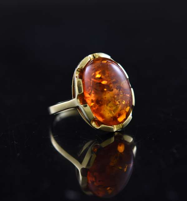 Jewelry - Stamped 14k yellow gold ring with 17 x 12 mm oval amber cabochon, approx. size 8, 4.7 grams