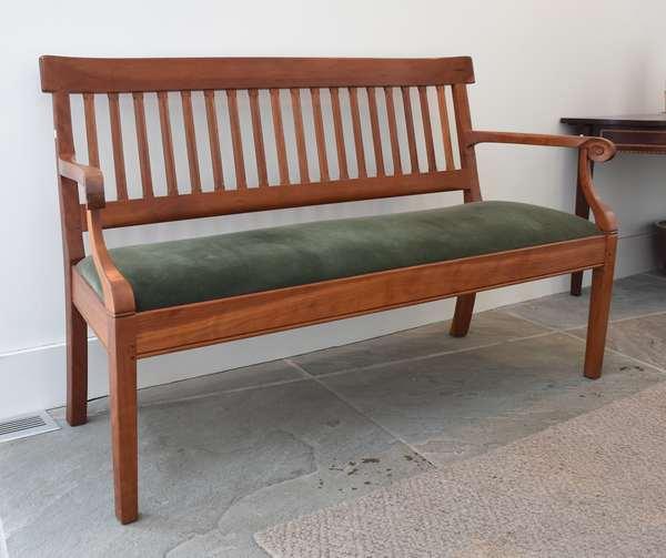 Cherry slat-back Shackleton bench with green upholstered slip seat, 55