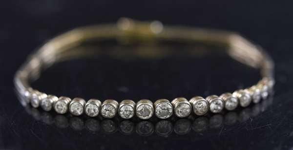 Jewelry - Tested 10k yellow gold diamond bracelet set with eighteen Old European cut diamonds, approx. 1.25 ct tw, 7.25