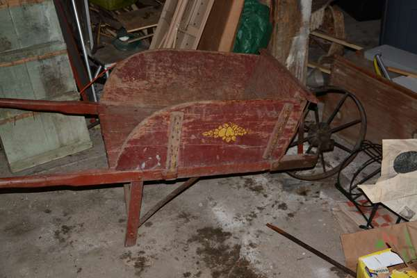 Antique red painted wood wheel barrel  (96-16)