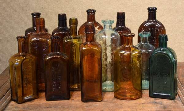 Good assortment of 14 medicine bottles, including Warner's kidney & liver cure (with label) Dr. Langley's, etc. (477-7)