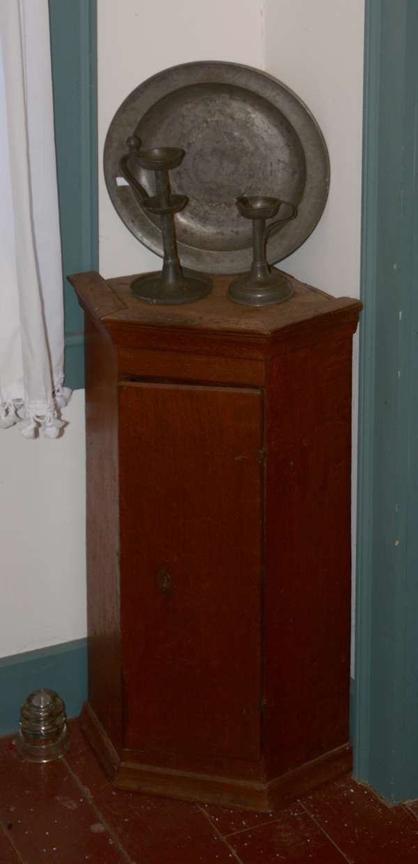 *Items to be sold separately* 19th C. country small size corner cupboard (96-21)  Two early pewter lighting devices (96-22)