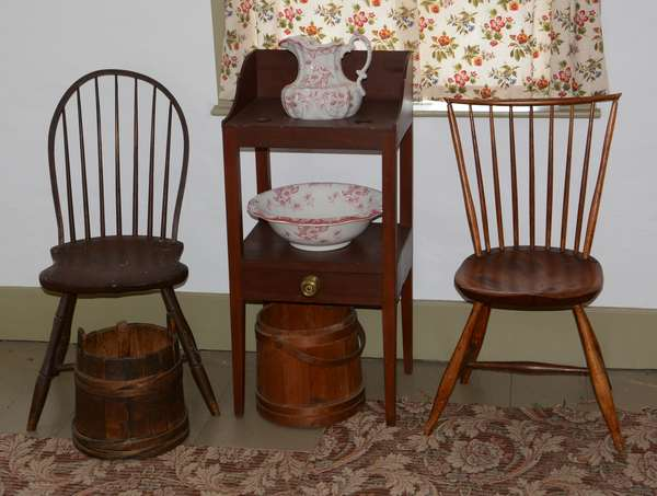 *Items to be sold separately* Two antique Windsor chairs (96-29)  Country Federal cherry basin stand (96-30)  Wash bowl & pitcher (96-31)  Two early buckets (96-32)