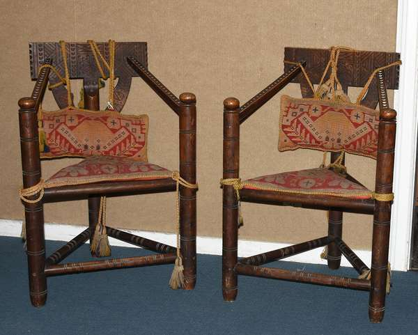 Pilgrim style three legged carved oak chairs, in the manner of Wallace Nutting (105-66)
