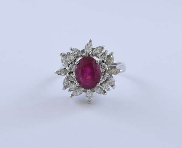 3.05 ct oval Burma ruby ring with approx. 1.5 ctw diamonds set in platinum, AGL cert indicating no heat enhancements