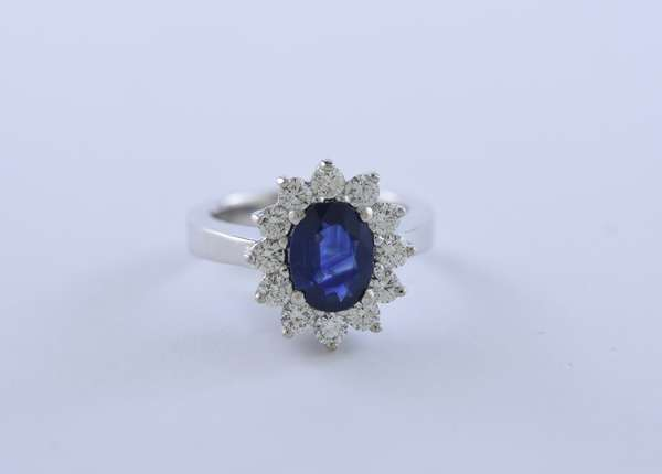 Good sapphire and diamond ring set in platinum, approx. 2.5 ct oval sapphire with approx. 1.2 ctw diamonds, size 6.5