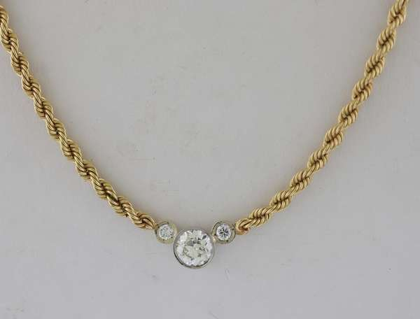 Pretty three stone diamond necklace on 14k gold chain, center diamond approx. 1.3 ct with two others