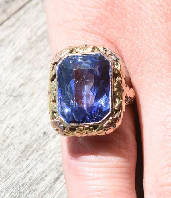 Lovely antique 14k gold and rose gold ring set with approx. 14-15 ct rectangular cut natural blue sapphire(A late edition from a local estate, the buyer has 25 days from the date of auction to re affirm the fact that the stone is a natural sapphire)