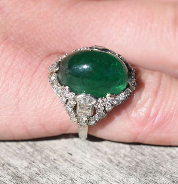 Important Edwardian platinum ring set with approx. 11.26ct cabochon emerald and approx. 1 ctw. of round, marquise and emerald cut diamonds. Cert states Russian origin, F2 Ring size 4.5
