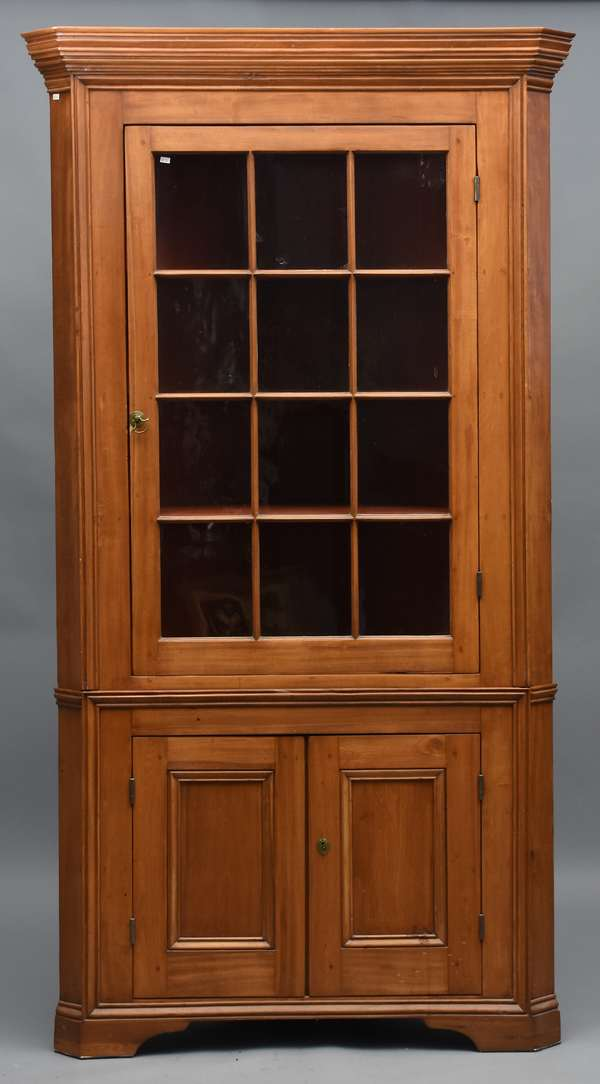 Good Federal two-part maple corner cupboard, twelve pane light glass door top, ca.1800, 85