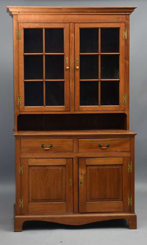 Chippendale walnut two-part set-back cupboard. Sectional glass door top, two dovetailed drawers and two doors in bottom, bracket feet, ca.1780-1800,47