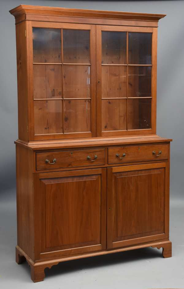 Two-part Chippendale Southern bookcase, with glass door top, drawers and doors below, 47