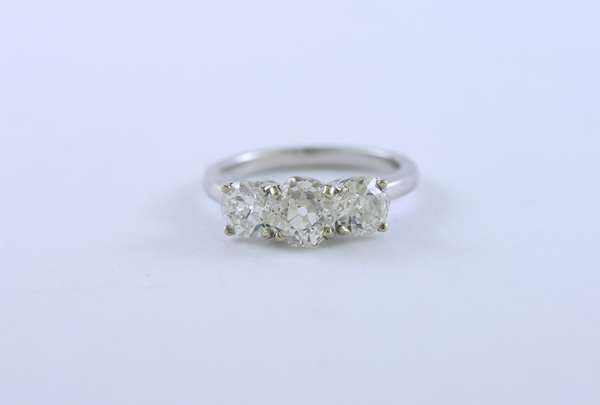 14k white gold three stone diamond ring, center stone approx 1.2 ct. old mine cut with 2 others on either side approx .60 ct each, ring size 6--see appraisal