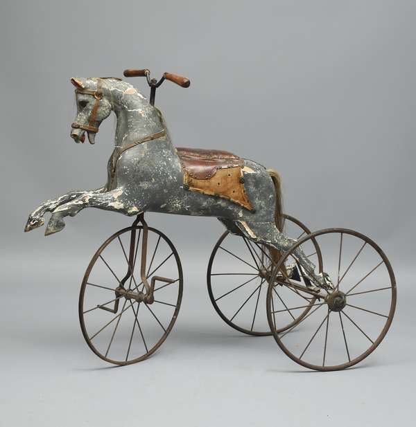 Good 19th C. child's horse velocipede, iron axles and wheels, horse well carved wood, with gesso and dapple painted, 37
