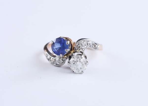 Tested 18k rose gold ring with platinum top set with approx. .60 ct old European cut diamond and approx. .50 ct blue sapphire accented by approx. .25 ct tw side diamonds, size 6.5, 3.8 grams