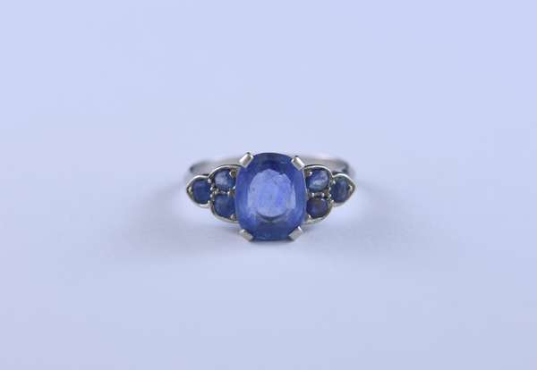 Platinum and light blue sapphire ring set with approx. 2.5 ct cushion cut sapphire accented by approx. .50 ct tw sapphire side stones, size 7.25, 5.4 grams