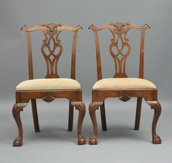 Fine set of eight bench made Chippendale style walnut dining chairs, with shell and other great carvings, carved by a PA master craftsman Ken Heiser