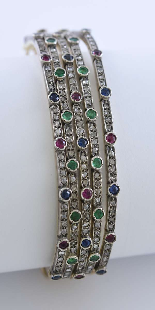Yellow gold hinged stacking bangle bracelet set with approx. 3.5 ct tw sapphire, ruby, emerald and rose cut diamonds, .5