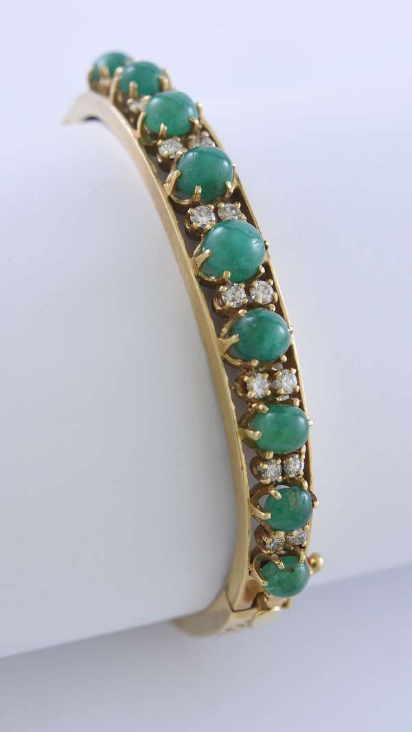14k yellow gold bangle bracelet set with 9 cabochon emeralds and 16 diamonds, 23 grams