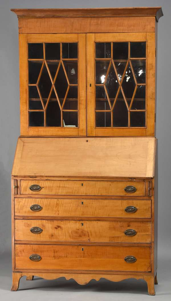 Two-part Federal tiger maple secretary desk with bookcase top, on flared French feet, with a good tiger maple interior, ca.1800, 39