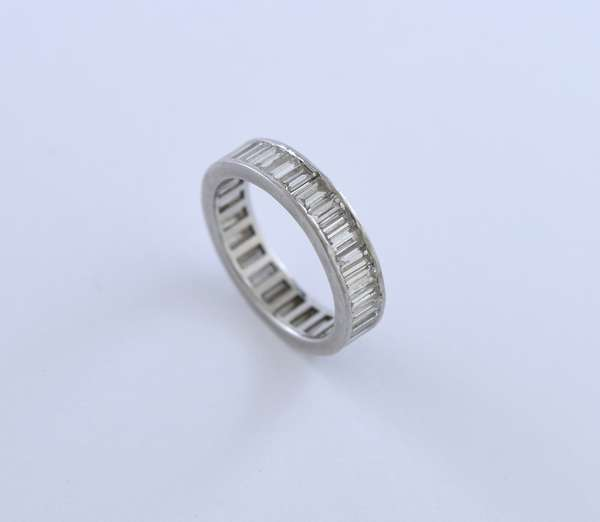 Platinum diamond eternity band set with approx. 3 ct tw emerald cut diamonds, size 5.5