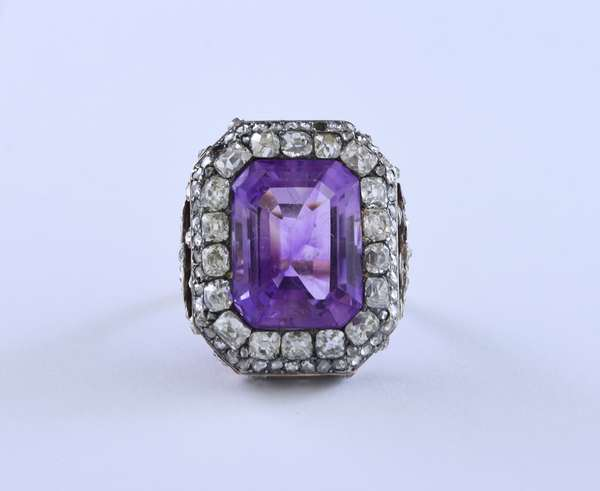 Beautiful antique dinner ring in 14k (tested) yellow gold set with an approx. 13 ct amethyst, topped with silver and accented by eighteen old mine cut diamonds approx. 2.88 ct tw and approx. .45 ct tw rose cut diamonds, size 6, 12.1 grams
