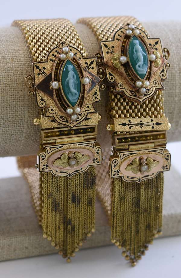 Pair of antique 14k yellow gold bracelets adorned with pearls, black enamel and carved cameos, approx. 110 grams, 7/8