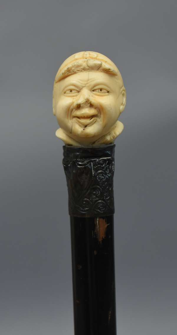 Wooden cane with carved ivory topper of the Great Bambino Babe Ruth, 35
