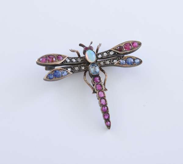 Silver and gold dragonfly pin set with sapphires, rubies, diamonds and an opal center, approx. 2.5 ct tw gemstones, 8.2 grams