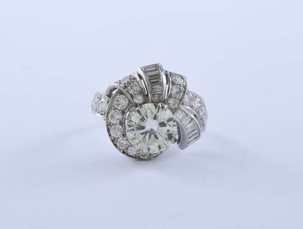 Approx. 2.5-2.75 ct round diamond ring, accented with another 2 ctw of diamonds in platinum