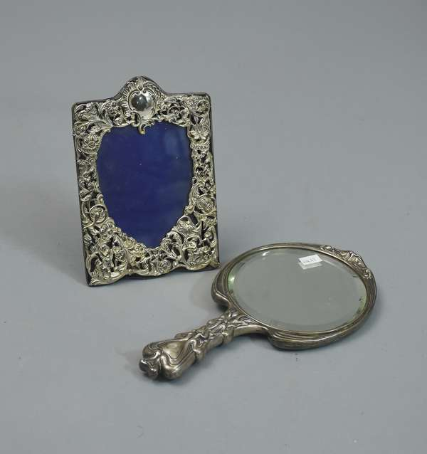 Ornate silver frame and mirror