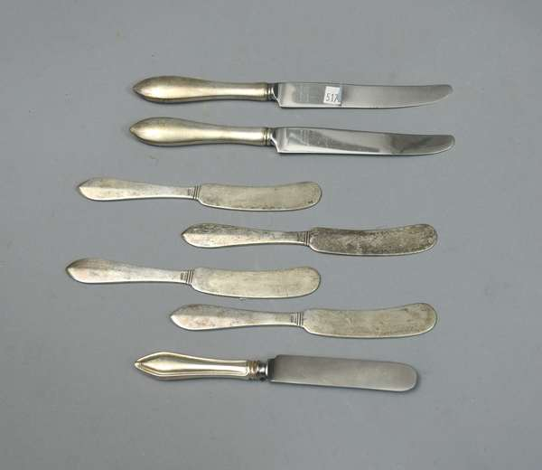 Four matching sterling butter knives and three others