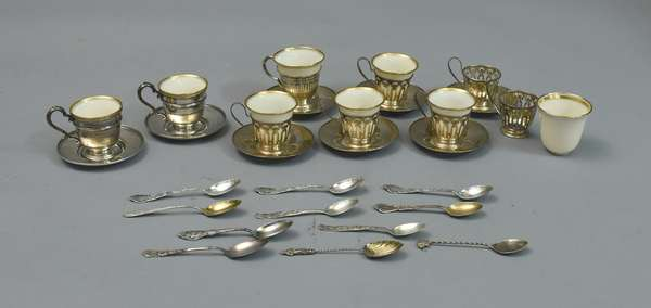 Sterling silver demitasse set, includes seven pierced cup holders, two solid, eight Lenox liners, eight s/s saucers, eleven assorted s/s spoons