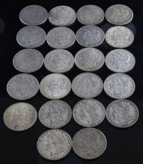 22 assorted Morgan silver dollars