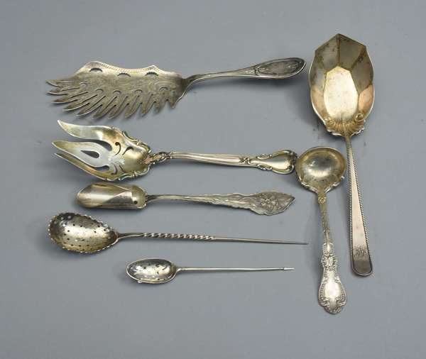 Seven ornate sterling serving flatware items; fish knife, cheese, etc., approx. 12.5 T. oz