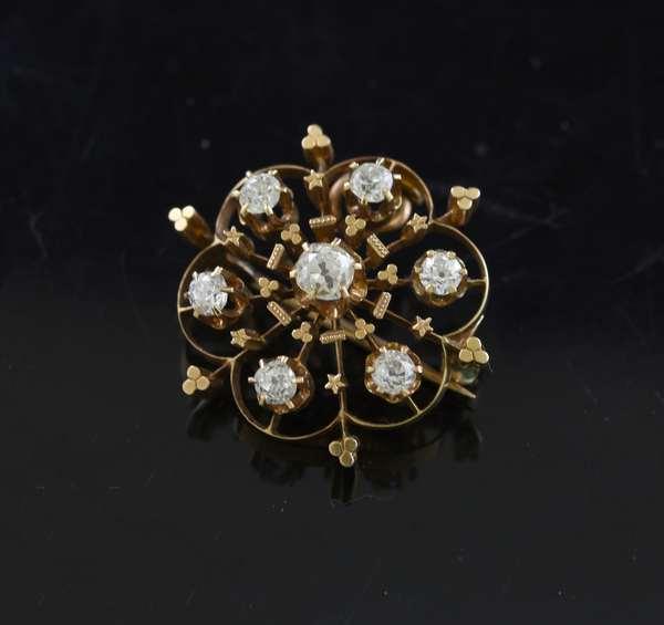 14k gold pin with 6 diamonds
