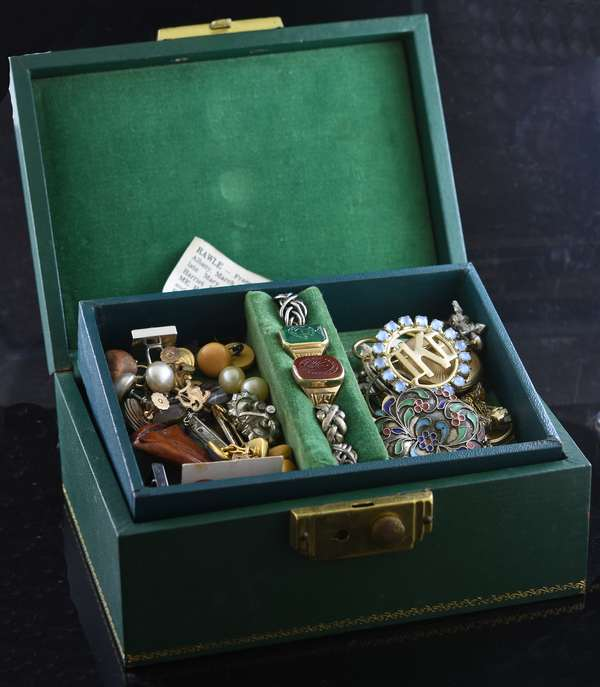 Green jewelry box with some gold