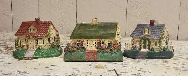 Three antique cast iron cottage doorstops, original paint