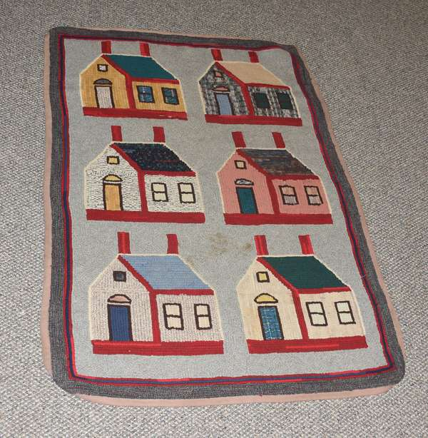 Antique hooked rug, houses