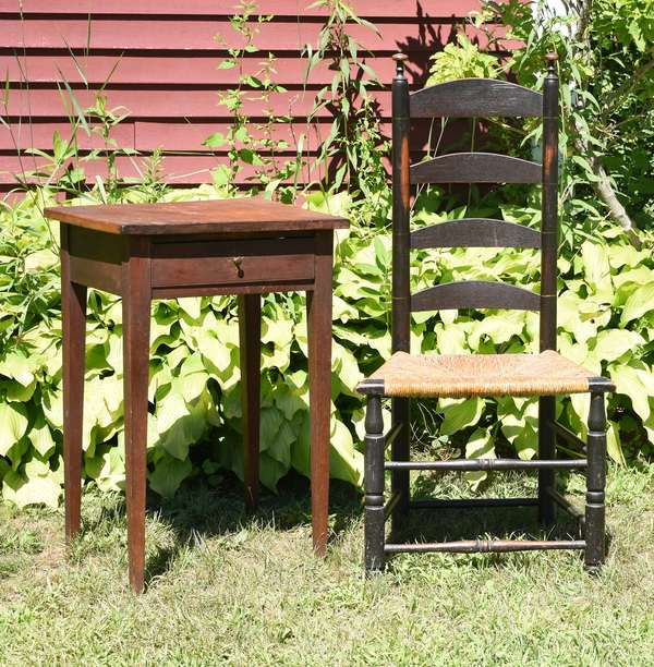 Hepplewhite cherry one drawer stand in old color with a ladder back chair in old black paint