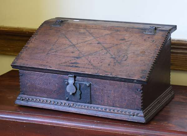 Late 17th C./early 18th C. small oak table top desk with chip carvings, original iron hardware, 10