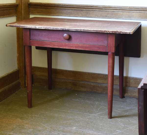 19th C. Shaker one drawer work table with single drop leaf and bottle legs, old red color, 30