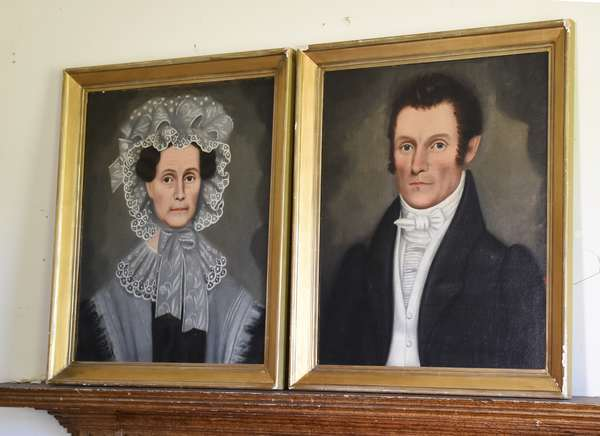 Pair of 19th C. oil on canvas laid on masonite portraits, man and woman, attributed to Erastus Salisbury Field, 24